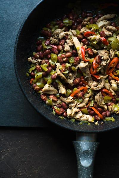 Frying pan with ready fajita closeup. Mexican cuisine.