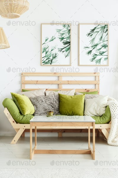 Wooden sofa with green cushions