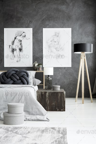 Grey bedroom with drawings