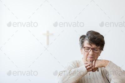 Grandma praying alone