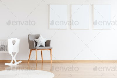 Empty posters on white wall