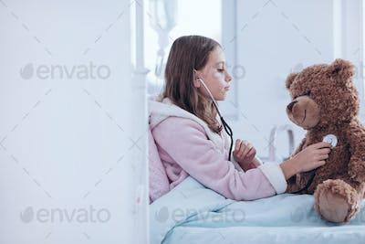 Sick girl and teddy bear