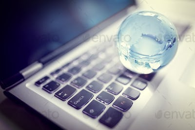 Crystal globe on laptop keyboard