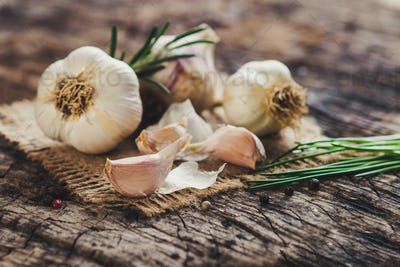 Fresh garlic on rustic background