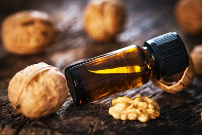 Walnuts oil on rustic wooden table
