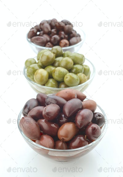 several bowls of homemade olive oil on white background