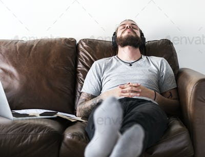 Caucasian man taking a break from work by listening to music