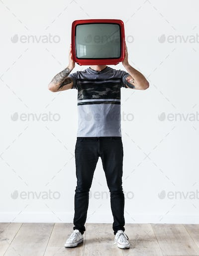 Person with tattoo holding television