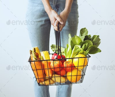 Woman holding vegetable basket