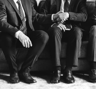 Business people sitting together on couch
