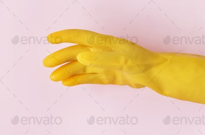 Closeup of hands wearing gloves domestic chores concept