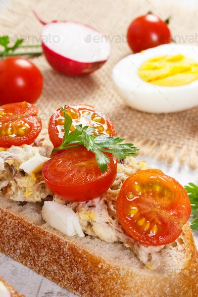 Closeup of sandwiches or baguette with mackerel or tuna fish paste, healthy nutrition