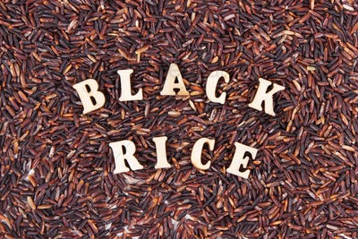 Heap of black rice as background, healthy gluten free food concept