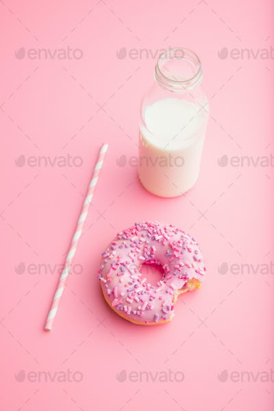 Pink donut and milk bottle.