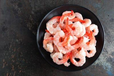 Fresh prawns. Raw shrimps, prawns. Seafood. Top view. Dark background