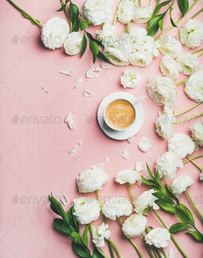 Flat-lay of cup of coffee and ranunculus flowers, copy space