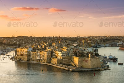 Senglea at sunrise in morning light with port