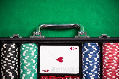 Suitcase with poker chips on poker table