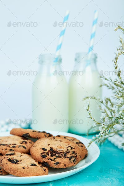 Cookie chocolate with a milk bottles.