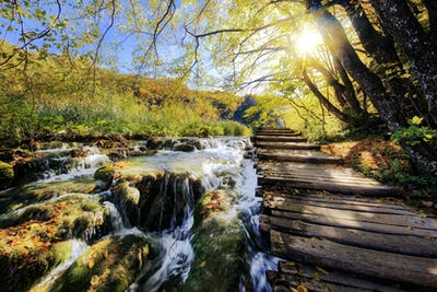 Waterfalls and pontoon in the sunshine in Plitvice National Park