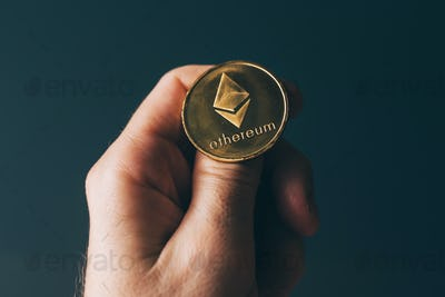 Ethereum cryptocurrency in hand