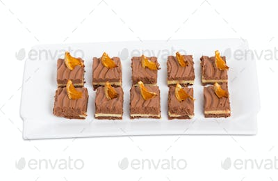 Delicious chocolate brownies with orange creme.