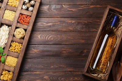 Various pasta in wooden box and wine