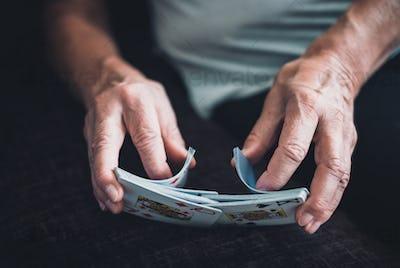 Woman shuffling cards