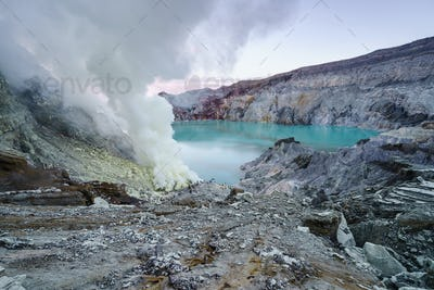 Sulfur burned in the crater blue lake at Kawah Ijen