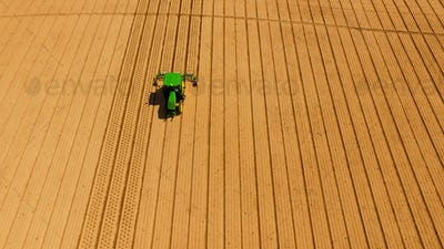 Green Tractor Plowing Aerating For New Planting Farm Agriculture