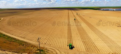 Tractors Run Parallel Plowing For New Planting Farm Agriculture