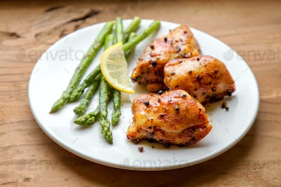 Plate of grilled chicken meat and asparagus