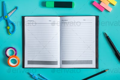 blank notebook with office tools around