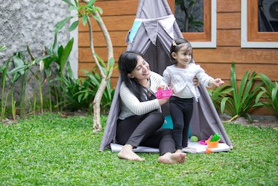 play toys with mother in tent