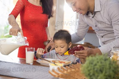 happy asian family having breakfast together