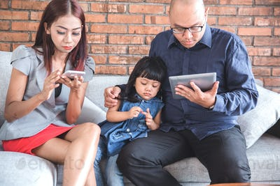 busy parenting using gadget