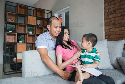 Family concept happy kid with book