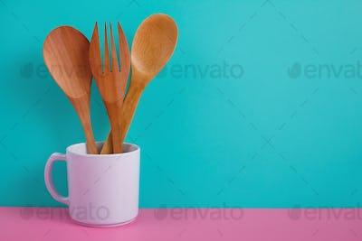 wooden kitchen utensils in white mug