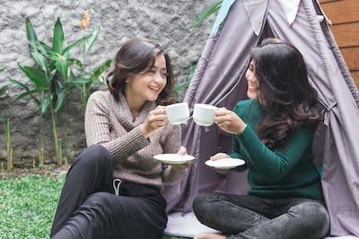 tea time in the backyard. two friends