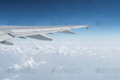 airplane wing in the sky, travel by plane