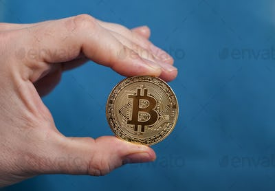 Man holding Bitcoin Cryptocurrency