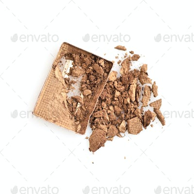 Smashed and cracked eye shadow isolated on white background. Top