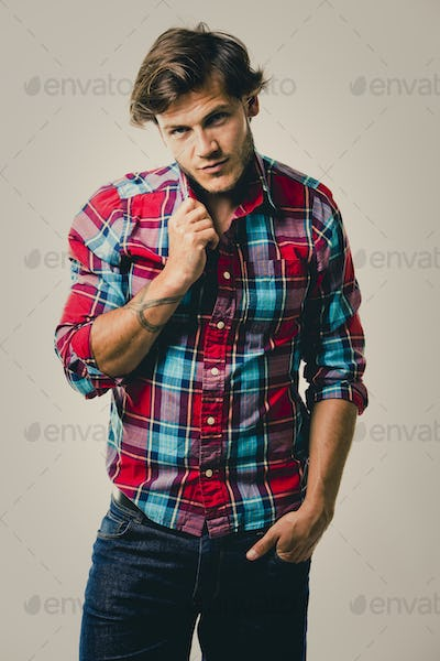ef279caaf4 caucasian man wearing checkered shirt and trendy hairstyle