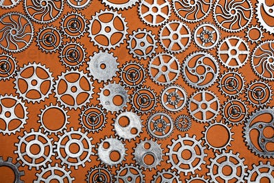 Bunch of cogwheels on an orange background.