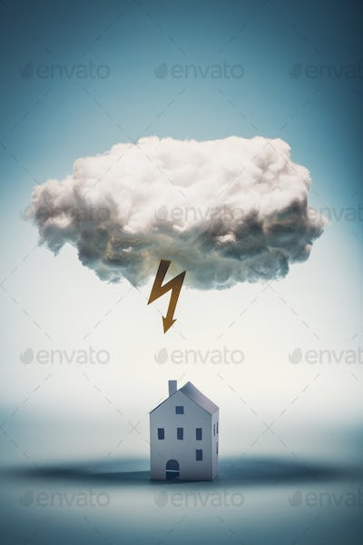 Paper house standing under a white cloud with yellow lightning