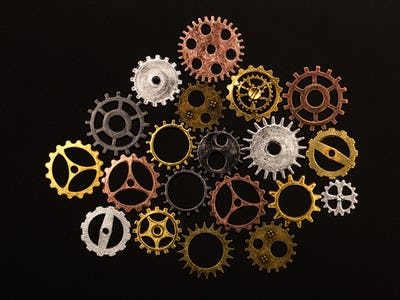 Group of different colorful cogwheels
