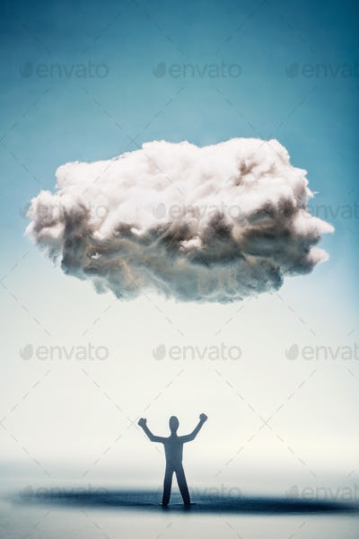 Angry man with clenched fists standing under a cloud.