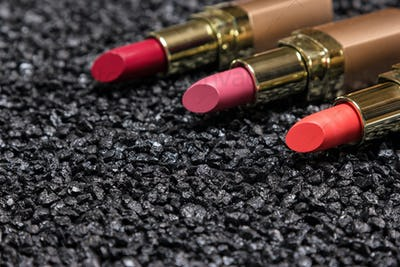 Closeup of lipstick on anthracite surface with copy space