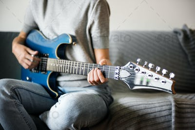 Woman playing an electric guitar