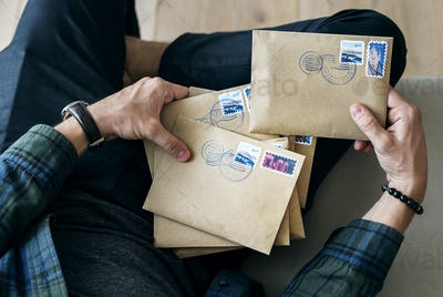 Aerial view of a man sorting an envelope